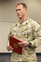 Staff Sgt. Andrew K. Thompson, with Marine Corps Forces Special Operations Command, speaks to peers after receiving the Silver Star at Camp Pendleton, Calif., March 12. Thompson from Bismarck, N.D., led his team and a company of Afghan National Army in an operation to clear a village in the Farah Province of Afghanistan, according to the citation.