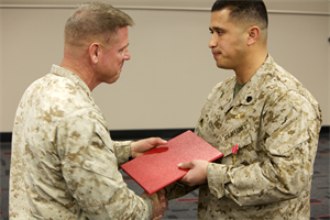 Staff Sgt. Maurice Scott, with Marine Special Operations Command, receives the Bronze Star, military's fourth highest award, at Camp Pendleton, Calif., March 12. Scott, 33, from Chicago, employed supporting aircraft to break lines and hinder enemy activities during a night helicopter raid, according to the citation.